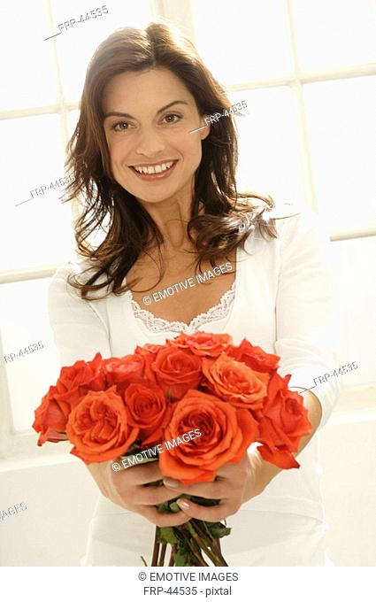 Woman presenting a bunch of roses