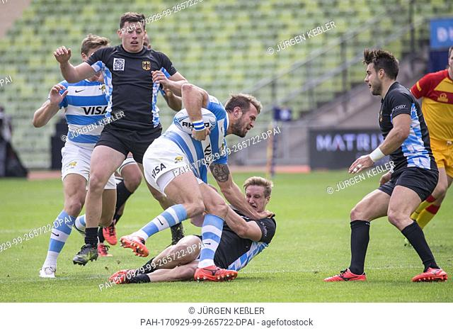 Sam Rainger tries to get Argentina's Fernando Luna down during the DHL Oktoberfest Sevens international rugby match between Germany and Argentina at the Olympic...