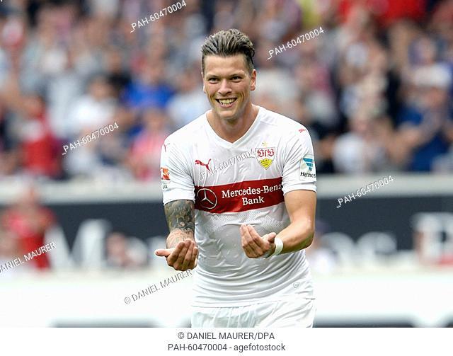 Stuttgart's Daniel Ginczek celebrates the 3:0 victory in a friendly match between VfB Stuttgart and Manchester City at the Mercedes-Benz Arena in Stuttgart