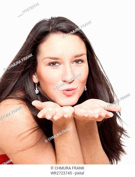 attractive, blow, blowing, brunette, Caucasian, cute, face, female, gesture, girl, hand, hands, isolated, kiss, love, one, person, portrait, romance, romantic