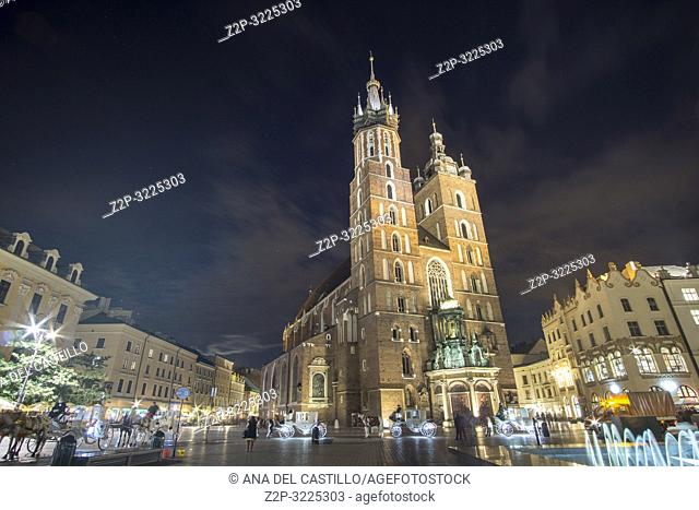 KRAKOW POLAND ON SEPTEMBER 25, 2018: The market square with St Mary basilica by dusk