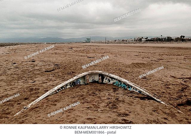 Sunken boat under beach sand