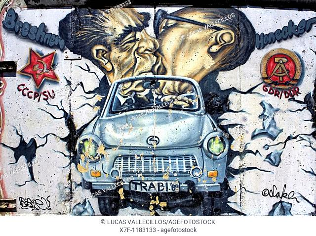 East Side Gallery  Brezner and Honecker kissing itself on trabi crossing the wall  Berlin  Germany