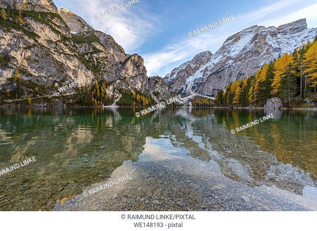 Croda del Becco, Seekofel, in the evening reflected in lake in autumn, Braies Lake, Lago di Braies, Pragser Wildsee, Bolzano Province, Bozen Province