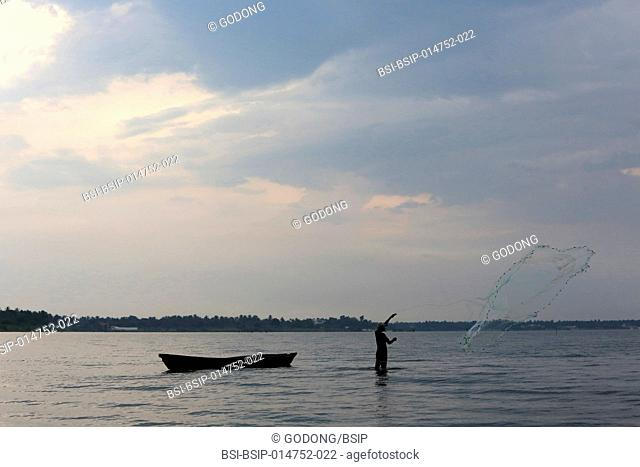 African fisherman with nets on Lake Togo