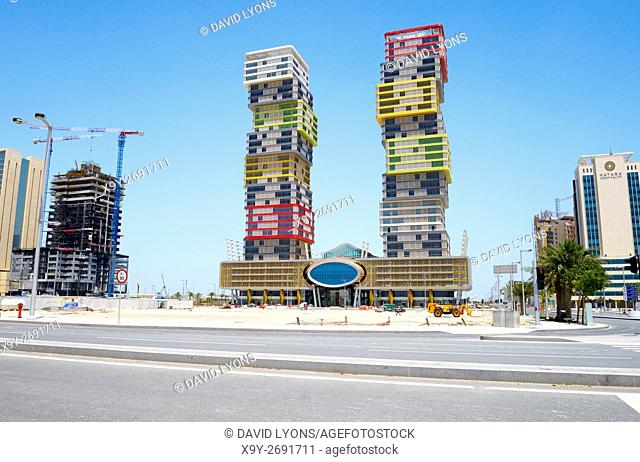 """Rapidly developing new city of Lusail, Qatar. The colourful Twin Towers high rise aka """"Building Blocks† in the Marina District"""