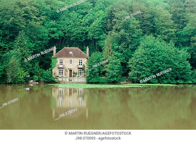 House at a lake in forest near Paimpol (Pempoull). Britanny. France