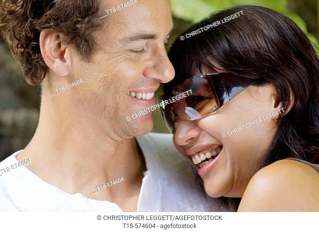 couple embracing and smiling
