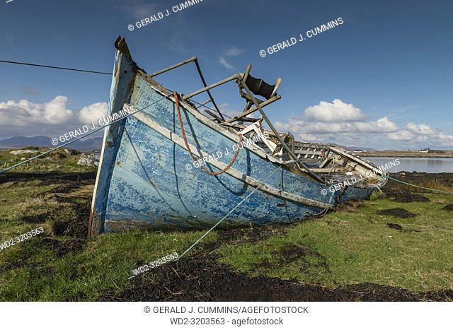 Old, derelict wooden fishing boat, left to rot on Irish coastline