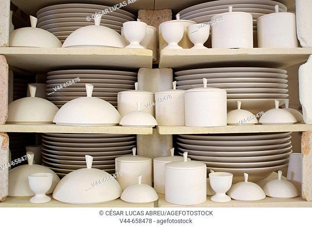 Pieces of porcelaine baking. La Fabrique, white porcelaine factory. Saint Brice. Limoge, France