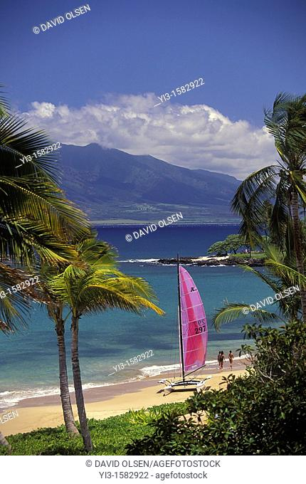 Sailboat on the beach with the West Maui Mountains behind at Wailea Beach, Maui, Hawaii