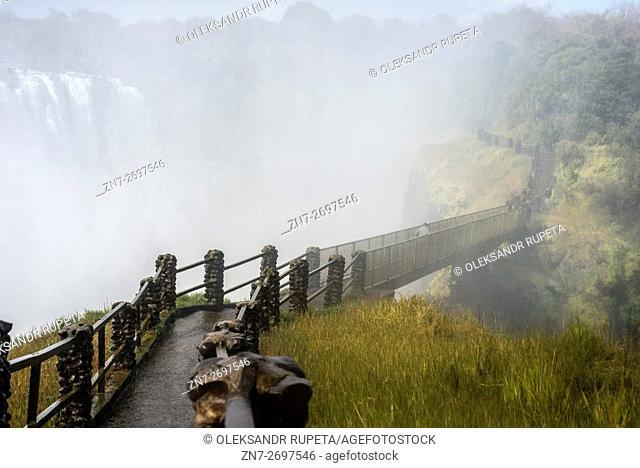 Visitors walk across the bridge near Victoria Falls, Livingstone, Zambia
