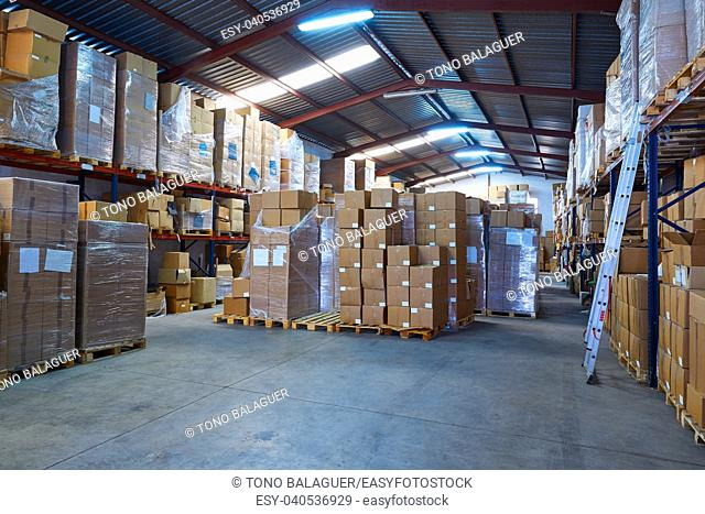 Warehouse stograge with stacked boxes in rows of a printing factory
