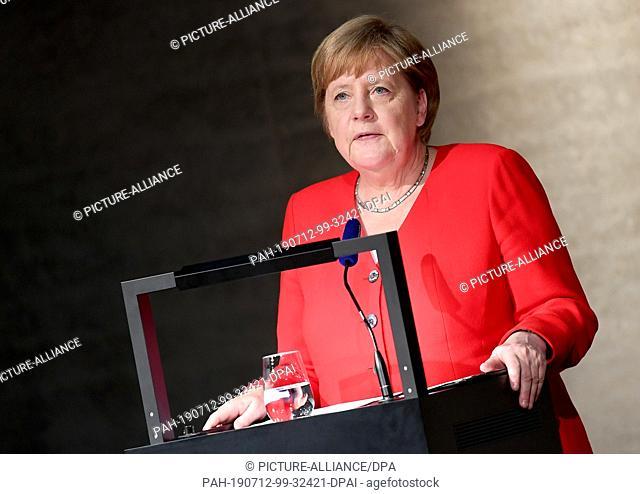 12 July 2019, Berlin: Chancellor Angela Merkel (CDU) speaks at the opening of the James Simon Gallery on Museum Island. Photo: Britta Pedersen/dpa