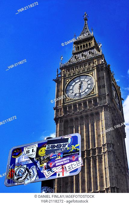 Big Ben in Westminster, London, England, with an official signboard which has been completely smothered with the stickers of mainly foreign political and...