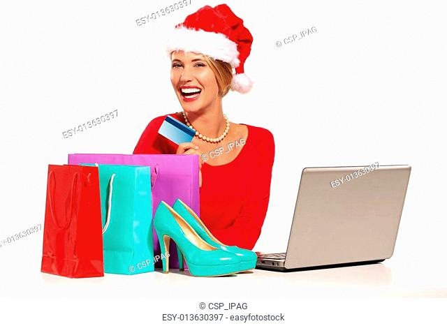Christmas woman on laptop doing internet shopping