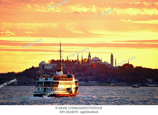 Bosphorus passenger ferry passes Seraglio Point, Topkapi Palace and Hagia Sophia, city centre of Istanbul, Turkey. Looking S. W