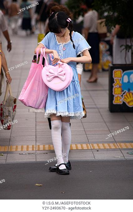Girl waiting in the street, Japan