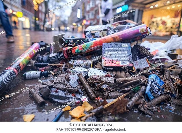 01 January 2019, Germany (German), Hannover: Burned down fireworks and other remains of New Year's Eve lie on Lister Platz....