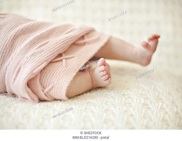 Close up of feet of newborn baby girl