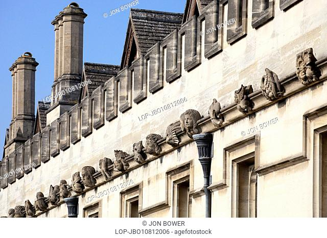An array of gargoyles and exotics adorning the walls of Magdalen College in Oxford
