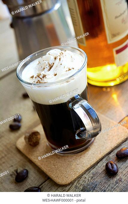 Irish coffee with some chocolate coffee beans and nutmeg