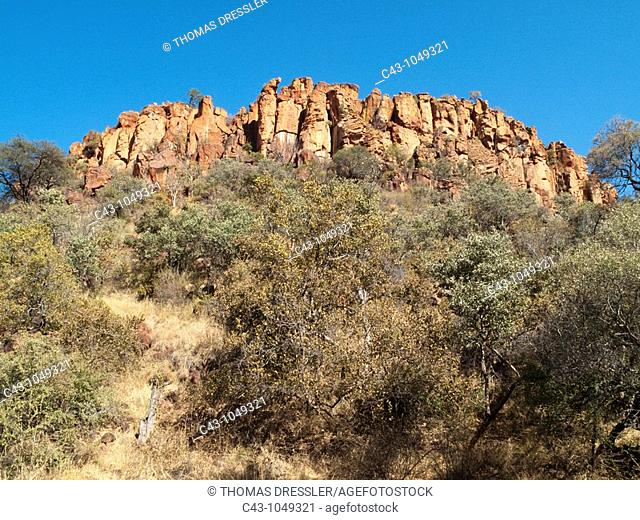 Namibia - The red sandstone rocks of the Waterberg Plateau high above the surrounding savannah  Waterbeg Plateau Park, Namibia