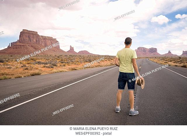 USA, Utah, Monument Valley, man standing on road