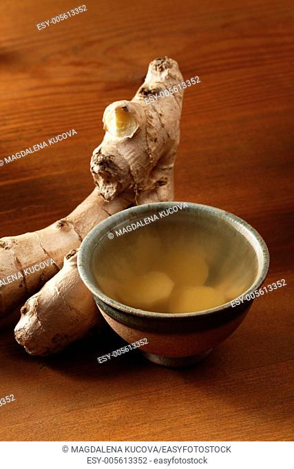 Cup of ginger tea and fresh ginger