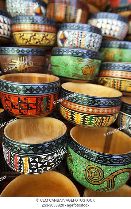 Close-up shot of of wooden bowls at the open-air art and craft market in Pisac, Sacred Valley, Cusco Region, Peru, South America
