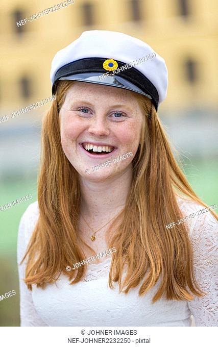 Teenage girl wearing graduation cap