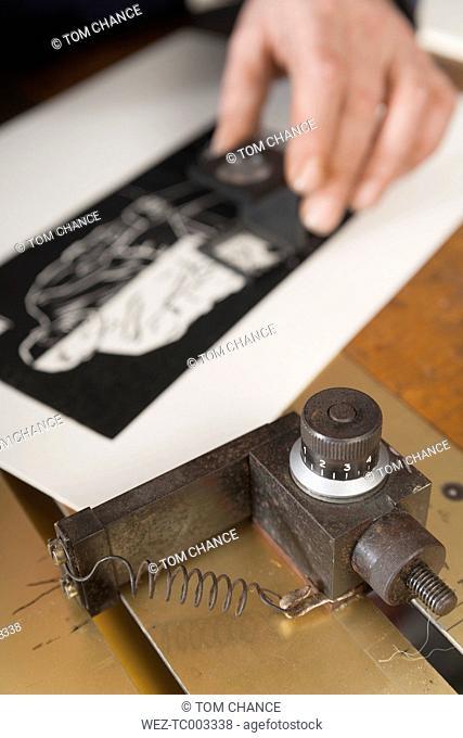 Germany, Bavaria, Man working in print shop