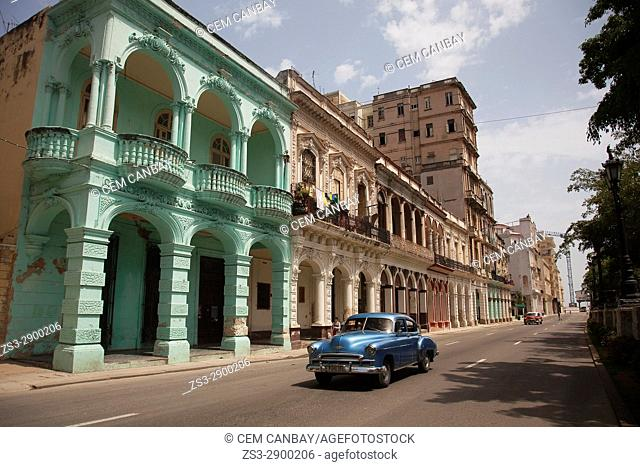 Old American car at the street in front of the colonial buildings in Central Havana, La Habana, Cuba, West Indies, Central America