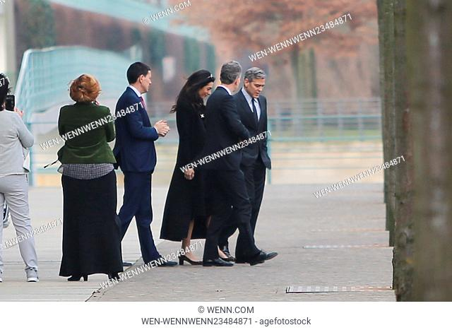 George Clooney and his wife Amal Clooney leaving Chancellory (Bundeskanzleramt) after a meeting with German chancellor Angela Merkel and heading back to Hotel...