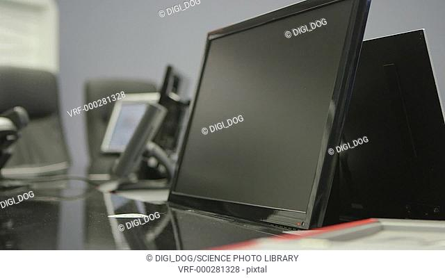 Automatic video conference screens on a meeting table