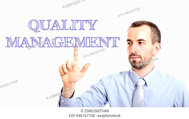 Quality Management Young businessman with small beard touching text - horizontal image