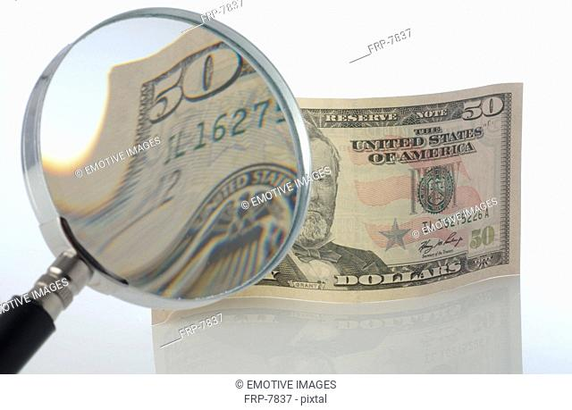 Dollar note under magnifying glass