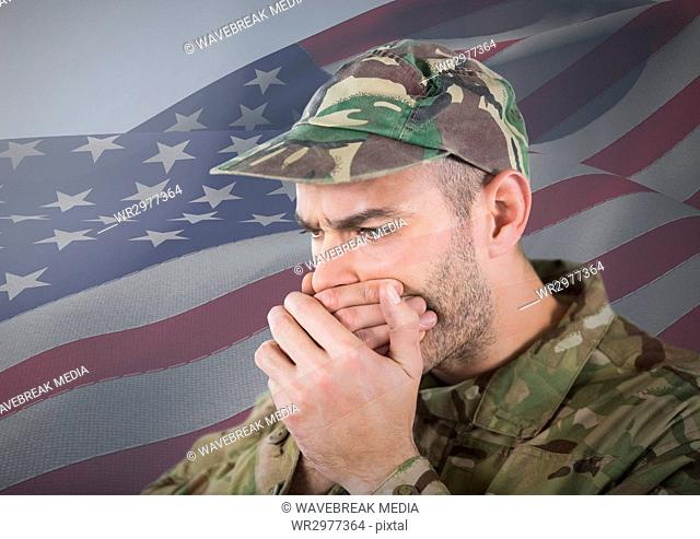 Soldier hiding his mouth with his hands in front of american flag
