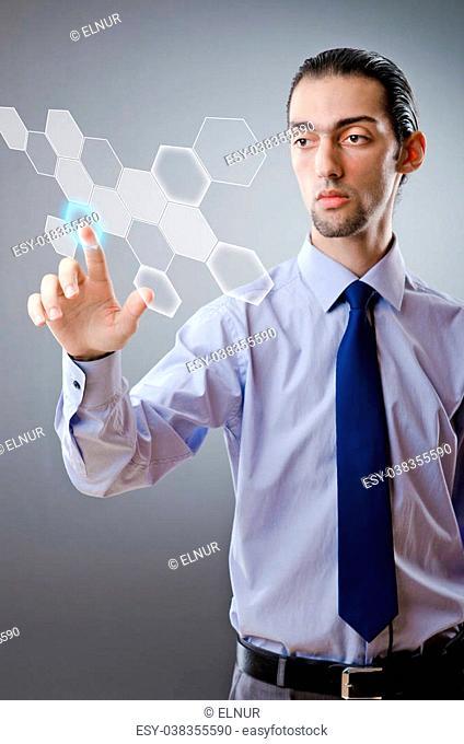 Businessman pressing virtual buttons
