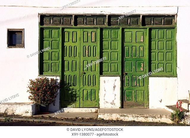 La Gomera, Canary Islands  Green painted old wooden doors in the village of El Cercado at the top end of Valle Gran Rey