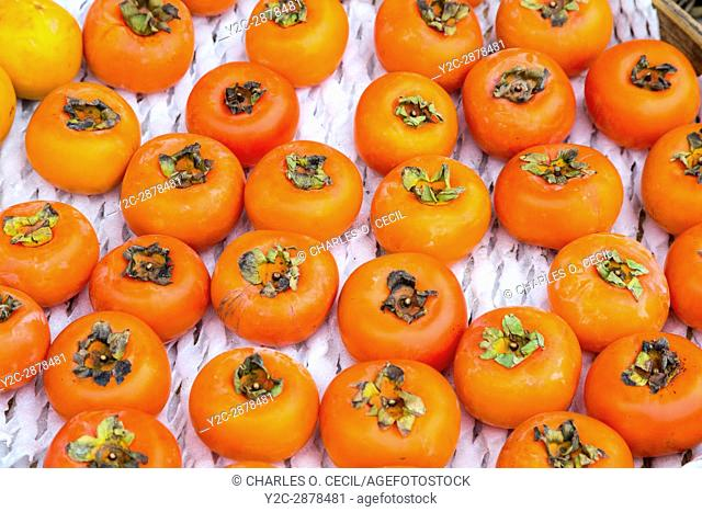 Yangshuo, China. Persimmons for Sale at Sidewalk Fruit Stand