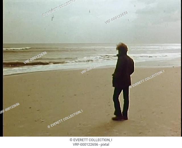 Long shot of man walking on beach1