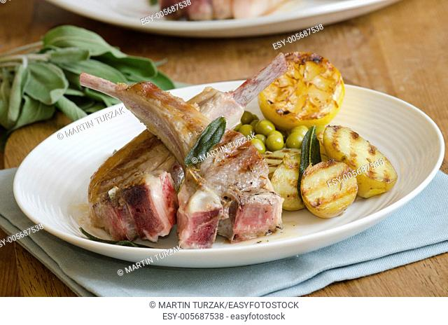 Lamb chops with roast potatoes and broad beans