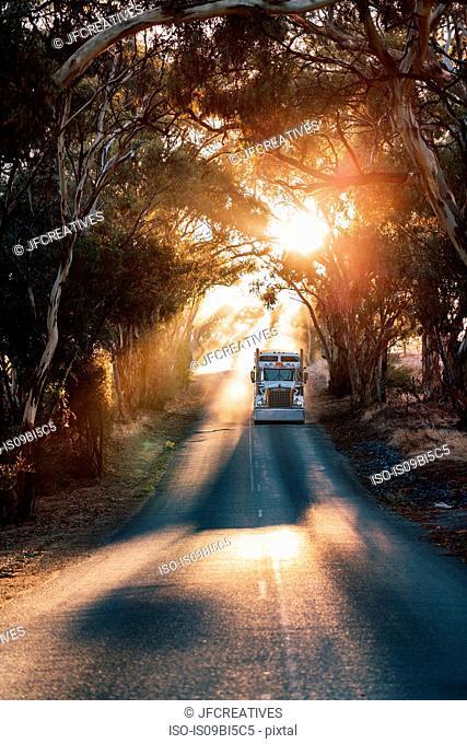 Truck travelling on road, Sevenhill, Clare Valley, South Australia, Australia