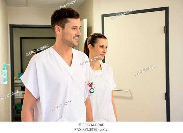 Doctor and nurse in a hospital corridor