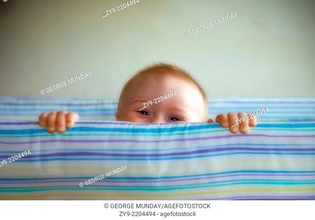 Young Toddler in Cot,