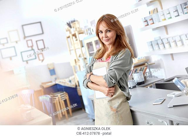 Portrait confident female business owner working in art shop