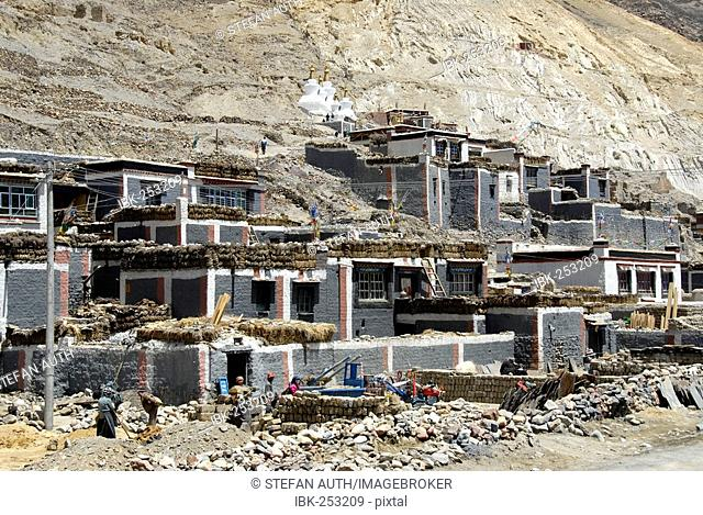 Tibetan Buddhism side buildung with private houses in grey and dark red painted walls Sakya Monastery Tibet China