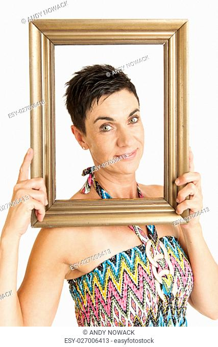 waist-view of a black-haired middle-aged woman with gilded picture frame against white background