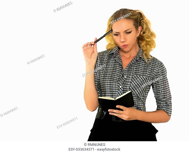 Beautiful, worried woman with black notebook and pen in hand. CAMERA